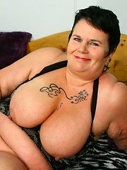Big mama with huge tits playing with herself