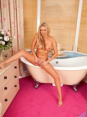 Busty naked housewife Amber Jayne shaves her wet pussy in the bathtub