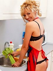 Cute housewife prepares dinner in her bra and thong