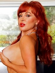 Red haired Anilos siren teases her hard nipples