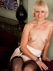 Petite blonde granny reveals her small natural tits and big nipples