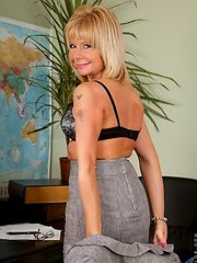 Elegant blonde Anilos woman strips down to her lingerie