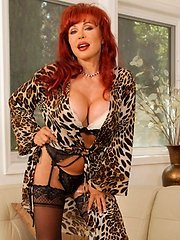 Milf slips off her robe exposing her curves in lingerie