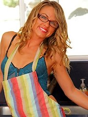 Housewife takes off her glasses and apron revealing lingerie