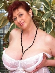 Huge breasted mature lady getting ready to be dirty