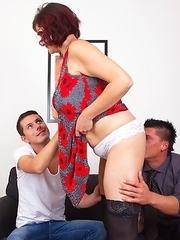 Hairy mature lady fooling around with two guys