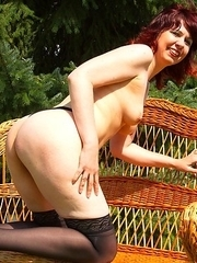 Naughty mama playing in the garden with herself