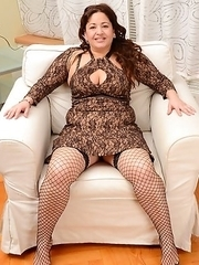 Naughty housewife teasing herself on the chair