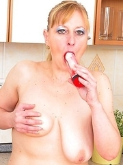 Horny housewife playing in the kitchen