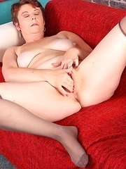 This mature slut loves to get wet on her couch